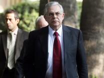Prime Minister designate Loukas Papapdemos exits the presidential