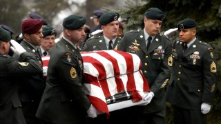 BODY OF US SOLDIER CARRIED INTO CHURCH