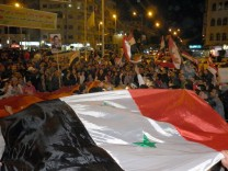 pro-Syrian demostrators during a protest held in front of the Qat