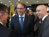 Germany's Finance State Secretary Asmussen talks with Bundesbank President Weidmann and Maleki head of Maleki Group as they arrive for the Euro Finance Week in Frankfurt