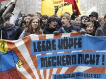 German pupils carry banner during demonstration in Berlin