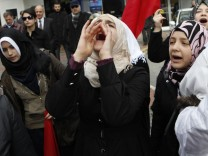A Syrian living in Turkey shouts slogans as they protest against the government of Syria's President Bashar al-Assad after Friday prayers in front of the Syrian consulate