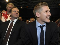 Bayern Munich's Bastian Schweinsteiger and sports manager Christian Nerlinger are seen before the annual meeting of the German Bundesliga first division soccer club in Munich November