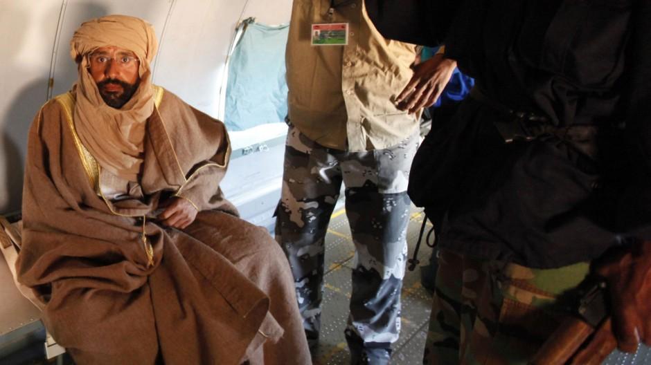 Saif al-Islam Gaddafi is pictured sitting in a plane in Zintan