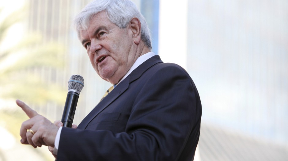 Republican presidential candidate Newt Gingrich gestures while speaking at the First Coast Tea Party town hall meeting at Jacksonville Landing in Jacksonville