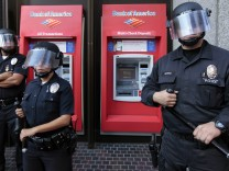 Los Angeles police keep protesters away from an ATM outside a Bank of America office at an Occupy LA protest in Los Angeles