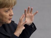 German Chancellor Angela Merkel speaks during a federal budget debate in Bundestag in Berlin
