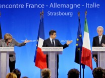 France's President Sarkozy, German Chancellor Merkel and Italy's PM Monti attend a news conference after a meeting to discuss the eurozone crisis in Strasbourg