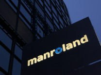A company logo is seen in front of the headquarter of Manroland in Offenbach