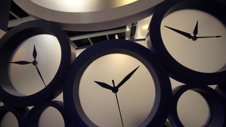 Clocks are seen at a booth at the Hong Kong Watch and Clock Fair 2010 in Hong Kong