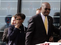 Herman Cain arrives with his wife Gloria at his side to announce that he is 'suspending' his Republican presidential campaign at his Georgia campaign headquarters in Atlanta