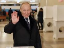 Russian Prime Minister Vladimir Putin votes at parliamentary elec