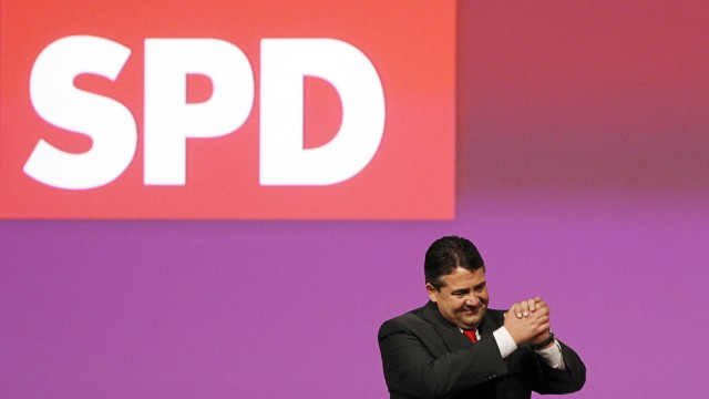 Leader of the Social Democratic Party (SPD) Sigmar Gabriel gestures after his speech at a SPD party convention in Berlin
