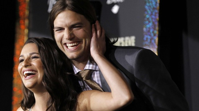 Cast members Kutcher and Michele greet each other during the premiere of 'New Year's Eve' in Hollywood