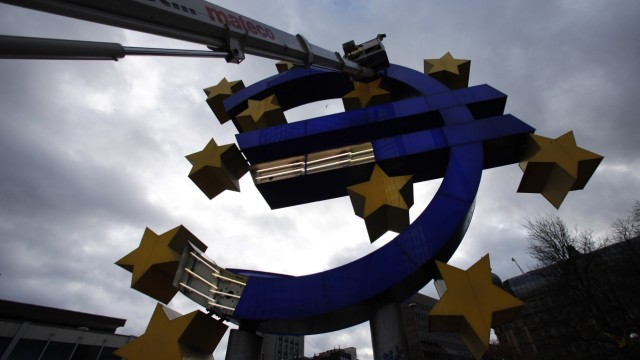 Workers maintain the huge Euro logo next to headquarters of ECB in Frankfurt