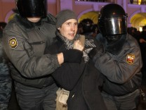 Russian police detain an opposition activist during a protest in St. Petersburg