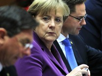 Slovenia's Prime Minister Barut Pahor, Germany's Chancellor Merkel and Finland's Prime Minister Katainen attend a European Union summit in Brussels