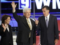 Republican presidential hopefuls U.S. Rep. Michelle Bachmann (R-MN), former Speaker of the U.S. House of Representatives Newt Gingrich (R-GA) and former Massachusetts Governor Mitt Romney pose before the first New Hampshire debate of the 2012 campaign at
