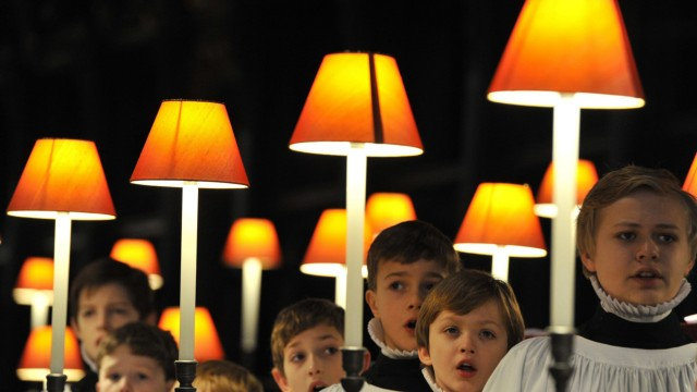 Choristers of  St Paul's Cathedral practice in the choir stalls at St Paul's Cathedral in the City of London