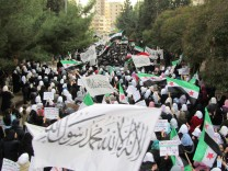 Demonstrators protesting against Syria's President Bashar al-Assad