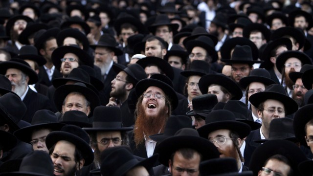 Ultra-Orthodox Jews pray during a protest against the gay pride parade in Jerusalem
