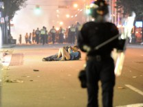 Couple Kisses During Vancouver Riot