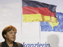German Chancellor Angela Merkel talks to journalists during a news conference at Pristina Airport