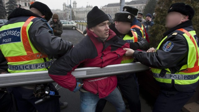 Hungarian opposition lawmakers chain themselves to parliament ga