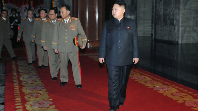 New North Korean leader Kim Jong-un walks with a row of top military officers at the Kumsusan Memorial Palace in Pyongyang