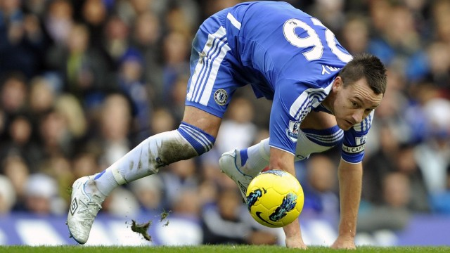 Chelsea's Terry loses control of the ball against Fulham during their English Premier League soccer match against Fulham in London