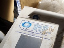 A box for a silicone gel breast implant manufactured by the now defunct French company Poly Implant Prothese (PIP) is seen inside an abandoned PIP building in La Seyne-sur-Mer near Toulon