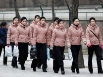 People Mourn North Korean Leader Kim Jong II In Beijing