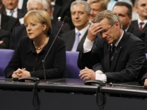 File photo of German Chancellor Merkel and CDU candidate Wulff waiting to hear the result of the German presidential election at the Reichstag in Berlin