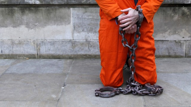 A demonstrator dressed as a prisoner protests against the U.S. prison at Guantanamo Bay outside the Ministry of Defence in London