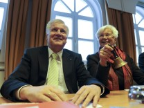 Seehofer reacts during Hasselfeldt rings a bell  in Wildbad Kreuth