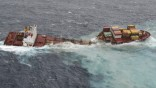 The stricken container ship Rena sits on a reef after it separated into two on the east coast of New Zealand's North Island