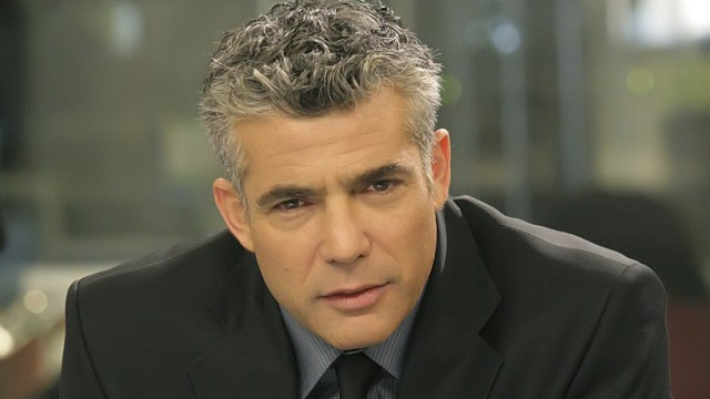 Israeli anchor Yair Lapid poses for a portrait in this undated handout photo