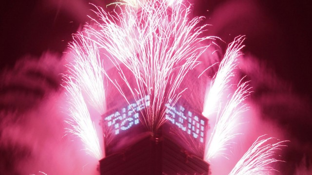 Fireworks explode from Taiwan's tallest skyscraper Taipei 101 during New Year celebrations in Taipei