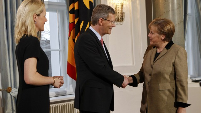 German President Wulff and his wife Bettina welcome Chancellor Merkel during a New Year reception for public life representatives in the presidential Bellevue palace in Berlin