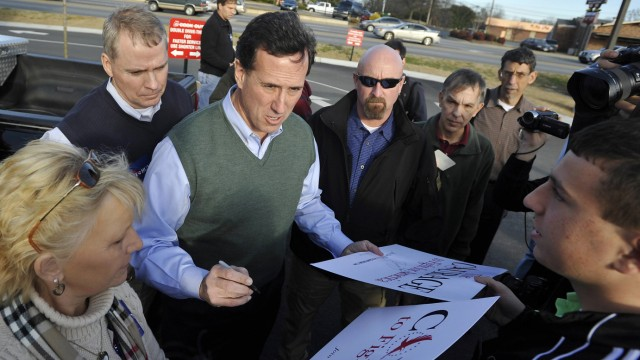 Republican presidential candidate Santorum greets supporters during a campaign stop in Gaffney