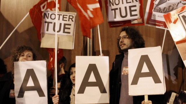 Demonstrators from the left-wing Parti de Gauche protest the rumored downgrade of France's AAA rating outside Standard and Poor's offices in Paris