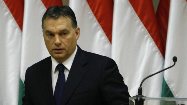 Hungary's PM Orban leaves the stage after presenting his speech during an agricultural conference in Budapest