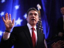 File photo of Republican presidential candidate Texas Governor Rick Perry gesturing during a debate in a Republican presidential candidates debate in Myrtle Beach