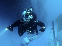 A scuba diver of Italian Navy inspects inside the Costa Concordia cruise ship which ran aground off the west coast of Italy at Giglio island