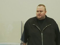 Still image from video shows founder of file-sharing website Megaupload Dotcom at court in Auckland