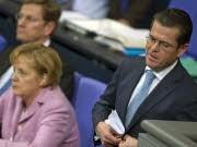 Karl-Theodor zu Guttenberg, Angela Merkel, AP
