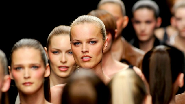 HERZEGOVA  DISPLAYS AMONG OTHER MODELS AT THE END OF PRADA COLLECTION IN MILAN