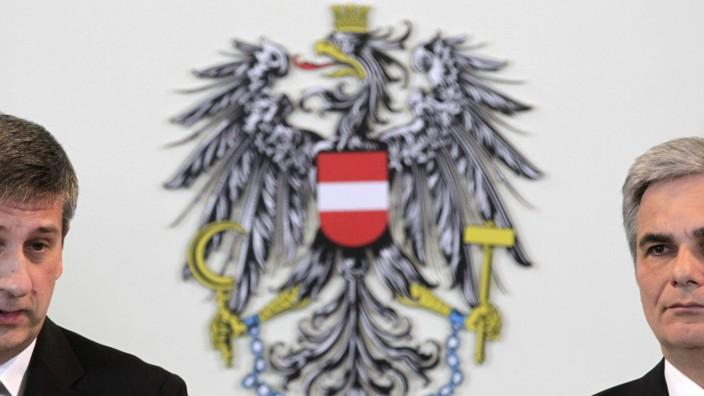Austria's Chancellor Faymann and Vice Chancellor Spindelegger brief the media in Vienna