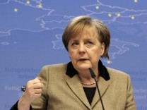 Germany's Chancellor Merkel holds a news conference after a European Union summit in Brussels