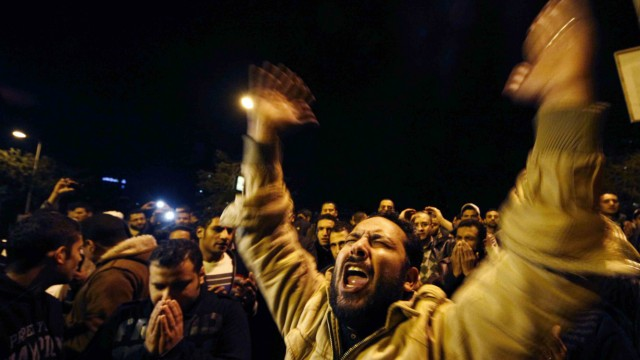 A man reacts at Ramses metro station in Cairo after the arrival of people wounded in clashes in Port Said stadium